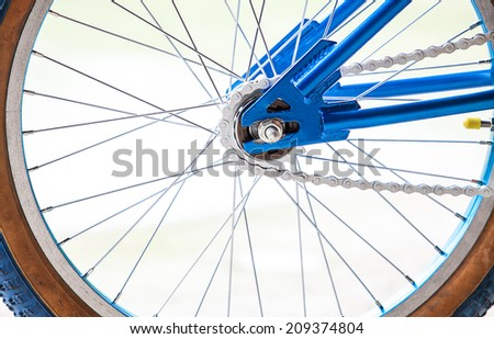 Detail of a Mountain Bike Tire with Four Lights in the Background - stock photo