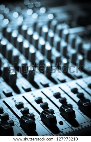 Detail of a music mixer desk with various knobs - stock photo