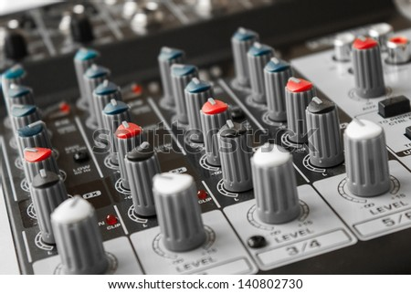 Detail of a music mixer in studio