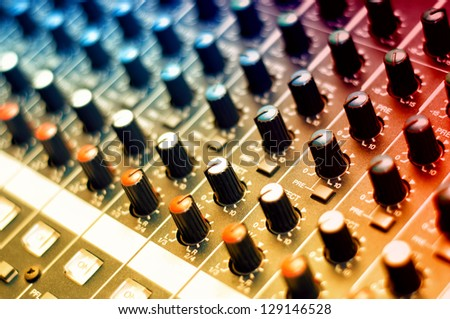 Detail of a music mixer in studio, dj working for a new song - stock photo