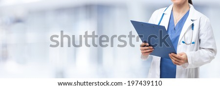 Detail of a nurse holding a clipboard - stock photo