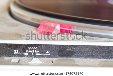 Detail of a old record player - speed controller - stock photo
