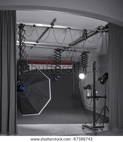 detail of a photo studio including camera and lighting equipment - stock photo