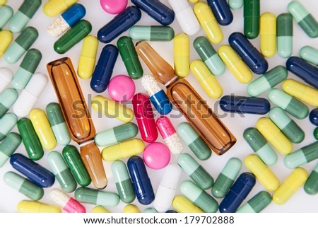 Detail of a pile of colorful medicine pills - stock photo