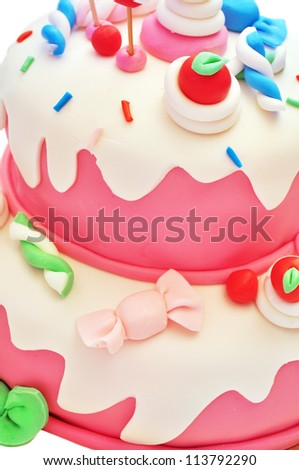 Detail of a pink birthday cake for girl - stock photo