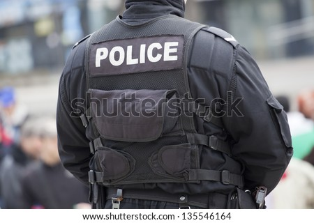 detail of a police officer - stock photo