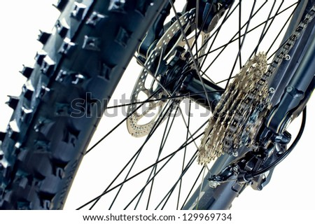 Detail of a rear tire, cassette, disc brake and rear derailleur of a brand new mountain bike - stock photo
