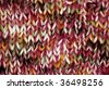 Detail of a red knitted scarf for background - stock photo