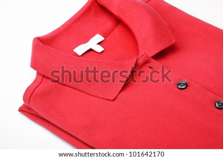 Detail of a red polo shirt. - stock photo