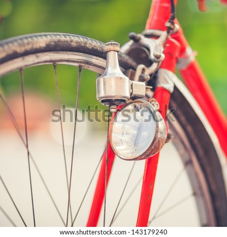 Detail of a Red Vintage Bike Front-light - stock photo