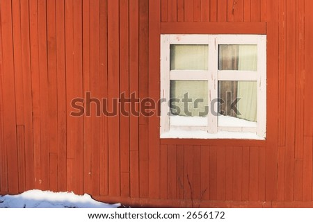 detail of a red wooden cabin. winter time. white window. - stock photo