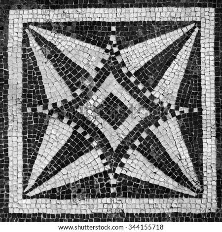 Detail of a Roman tile in Spoleto, Italy - stock photo