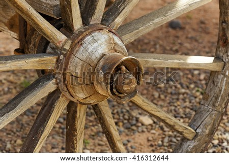 detail of a rustic wooden wagon wheel  - stock photo