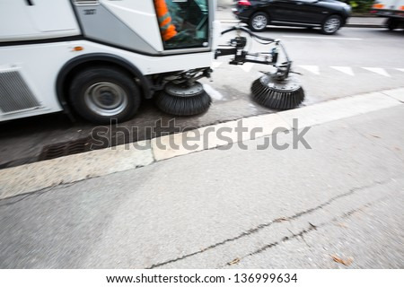 Detail of a street sweeper machine/car cleaning the road - stock photo