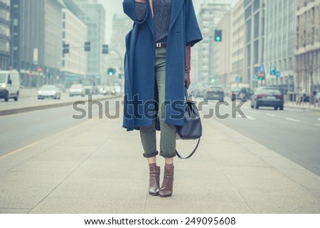 Detail of a stylish young woman posing in the city streets - stock photo