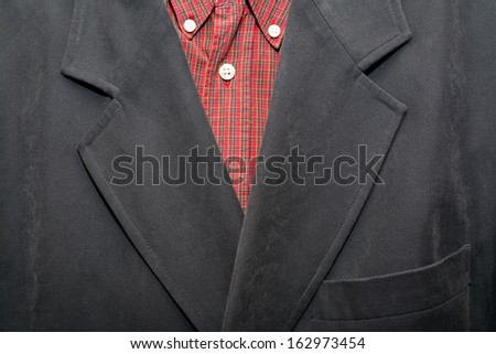 detail of a suit and shirt
