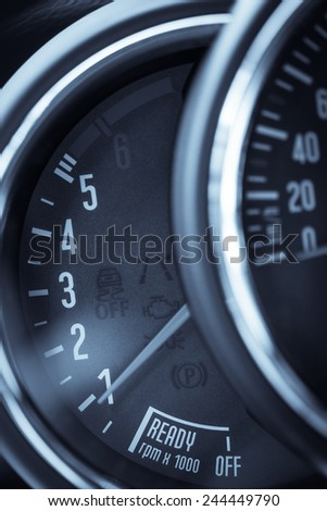 Detail of a tachometer in a car.
