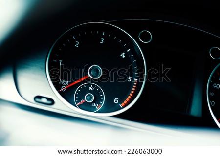 Detail of a tachometer in a car. Tachometer in a modern diesel car. - stock photo