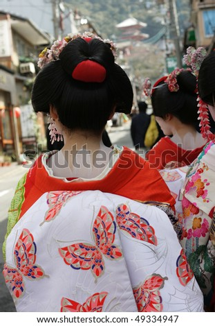 Detail of a the back of a Geisha girl, in a the streets of Kyoto.  Geisha girls are part of traditional Japanese culture that is still alive