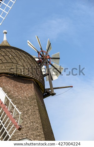 Detail of a typical windmill in Denmark a sunny summer. / Wind Mill in Denmark - stock photo