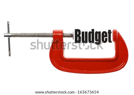 "Detail of a vice compressing the word ""Budget"". Business metaphor. - stock photo"