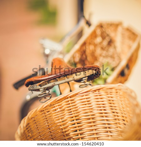 Detail of a Vintage Bike Seat with a Shopping Basket in Street in Paris, France - stock photo