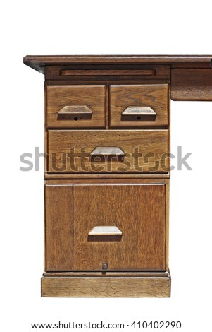 Detail of a vintage desk in a room isolated on white with clipping path, I see faces on it. - stock photo
