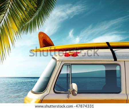 Detail of a vintage van in the beach with a surfboard on the roof - stock photo