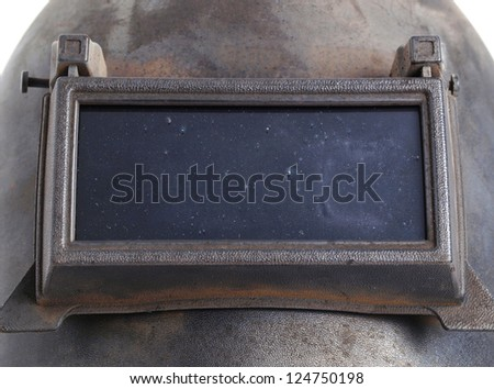 Detail of a visor welder mask. The photo shows the impacts of welding slag glass in the viewfinder. - stock photo