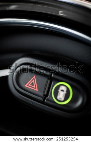 Detail of a warning button in a car. - stock photo