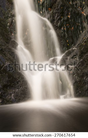 Detail of a waterfall in a mountain creek in the High Fens, Ardennes, Belgium, toned long exposure shot - stock photo