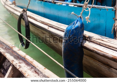 detail of a weathered wooden small boat