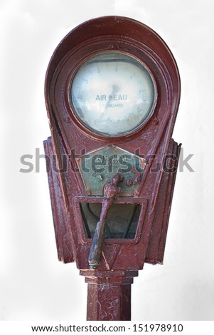 Detail of a white rusty old air pump in Salamanca, Spain - stock photo