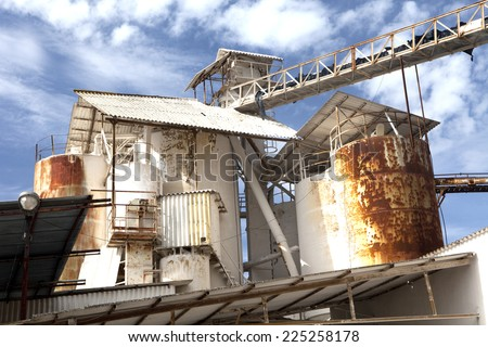 Detail of a white rusty old factory.  Old factory detail. - stock photo
