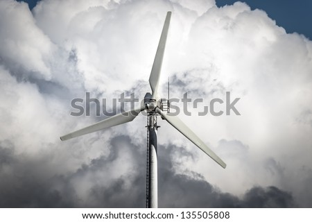 Detail of a windmill with storm clouds in background - stock photo