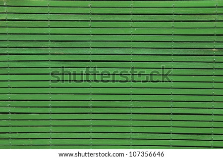 Detail of a wooden blind painted in green