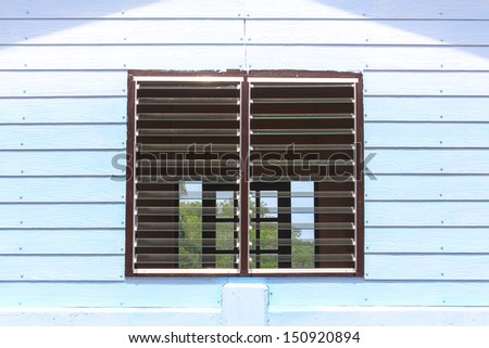 detail of a wooden window with shutters open