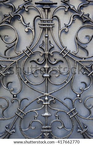 Detail of a wrought iron door of French mansion - stock photo