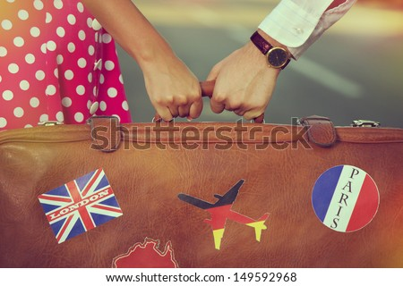 Detail of a young couple's journey - stock photo