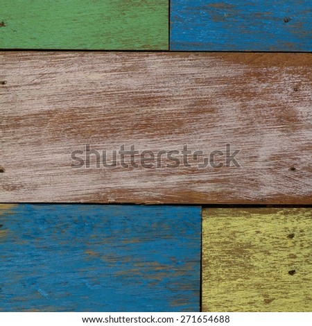 detail of abstract art color wood wall  yellow green blue  - stock photo