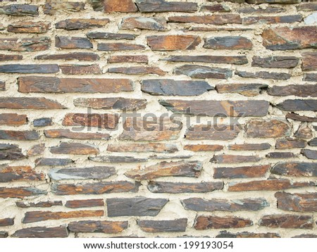 detail of aged stone wall