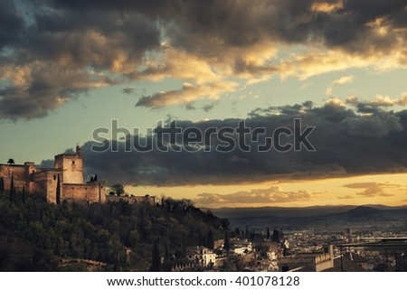 detail of Alhambra Palace in Granada,Sail tower. Andalusia at sunset. Moorish fortress - famous landmark and major touristic attraction in Spain - stock photo