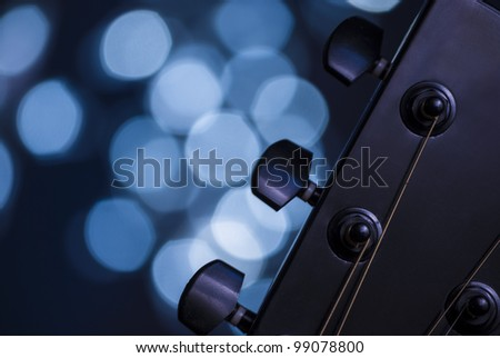 Detail of an acoustic guitar with a shallow depth of field - stock photo