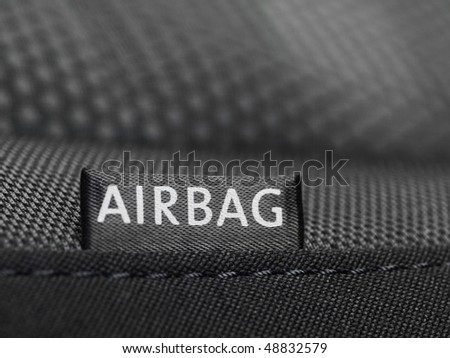 Detail of an airbag lable on the side of a car seat - stock photo