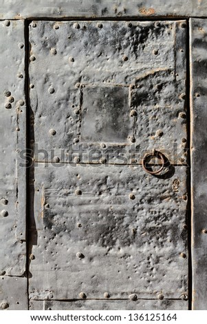 Detail of an ancient and sturdy metal door, in a castle - stock photo