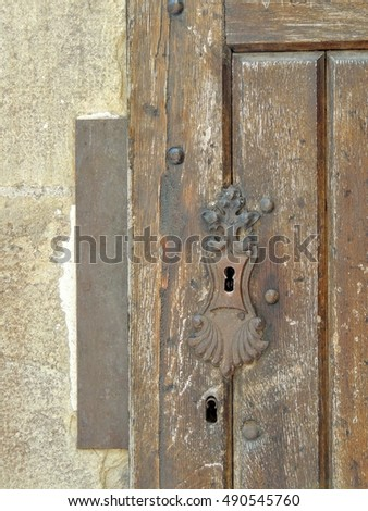 Detail of an antique wooden door with decorative metal keyhole cover & Lock On Door Old Wood House Stock Photo 557782357 - Shutterstock pezcame.com