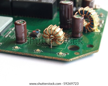 Detail of an electronic printed circuit board - selective focus - stock photo