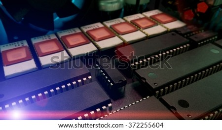 Detail of an electronic printed circuit board with many electrical components - stock photo