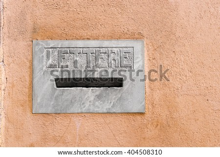 Detail of an Italian marble letterbox on a wall with text Lettere in italian language (Letters). Pistoia, Tuscany, Italy - stock photo