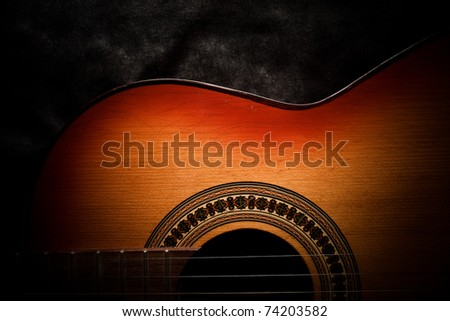 Detail of an old acoustic guitar - stock photo